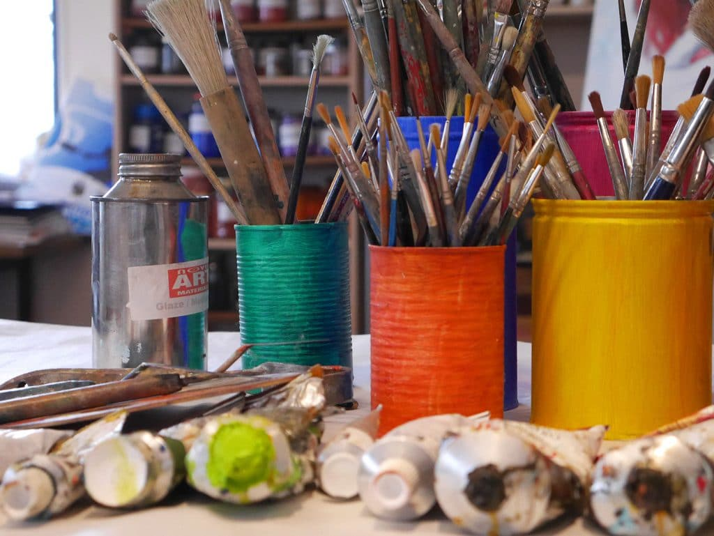 studio image brushes in coloured jars