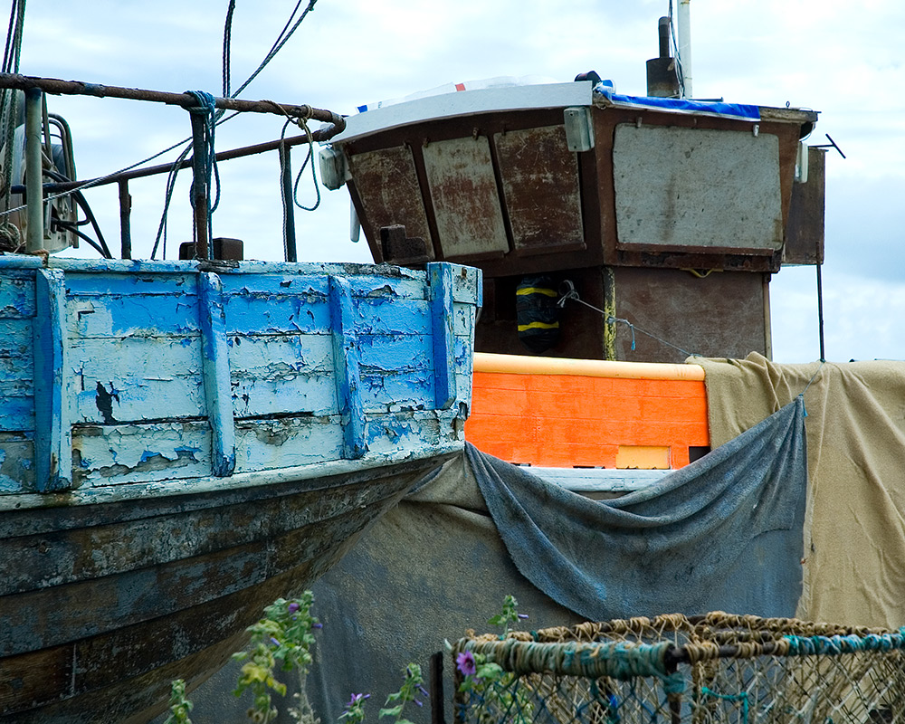 val carcary green boats blue and orange hastings beach