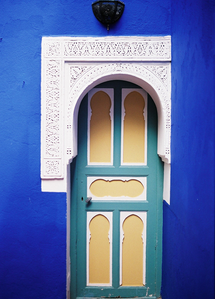 val carcary green yellow and turquoise door white canopy blue wall