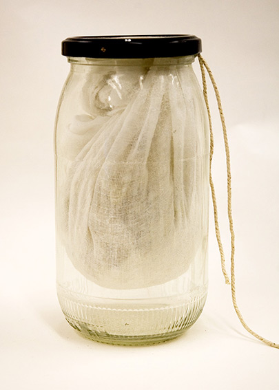 glass jar with damar in muslin