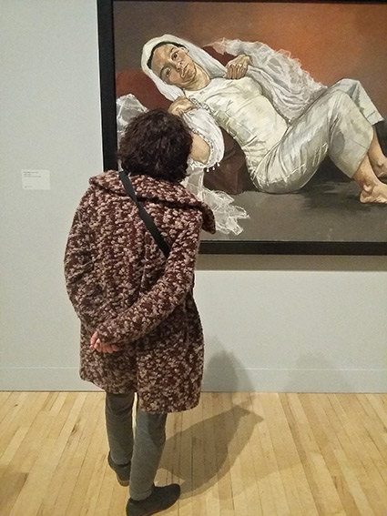 val from behind looking at paula rego pastel